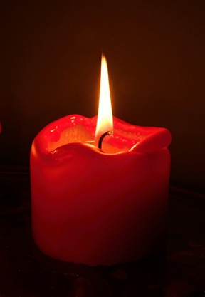 Red candles in front of a black background